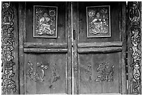 Decorated doors of a temple. Lijiang, Yunnan, China (black and white)
