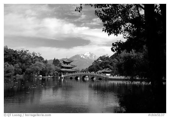 Pavillon reflected in the Black Dragon Pool, with Jade Dragon Snow Mountains in the background. Lijiang, Yunnan, China (black and white)