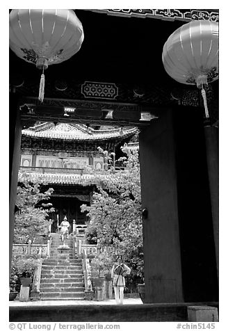 Ming dynasty Wufeng Lou (Five Phoenix Hall), seen through entrance arch. Lijiang, Yunnan, China (black and white)