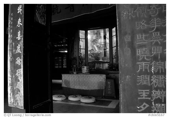 Buddha image and altar in Hongchunping temple. Emei Shan, Sichuan, China (black and white)