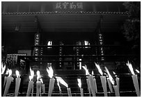 Candles burning in front of Wannian Si temple. Emei Shan, Sichuan, China (black and white)