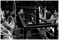 Pilgrims burning big incense batons. Emei Shan, Sichuan, China (black and white)