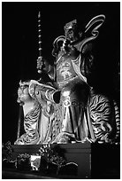 Sculpture inside Xiangfeng temple. Emei Shan, Sichuan, China (black and white)
