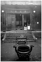 Urn in courtyard inside Xixiangchi temple. Emei Shan, Sichuan, China (black and white)