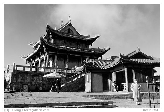Monk walking in front of Jinding Si temple. Emei Shan, Sichuan, China (black and white)