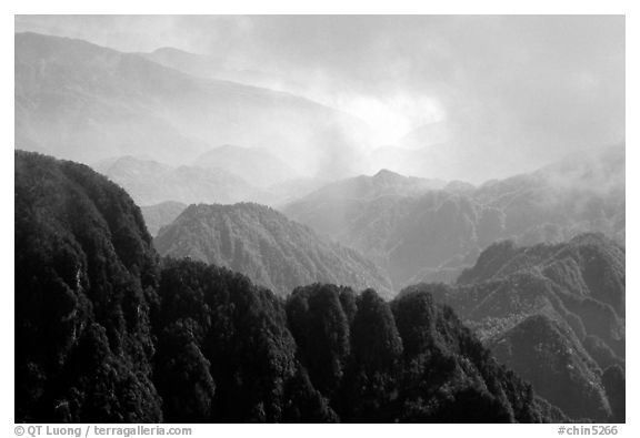 Forest-covered slopes and ridges of Emei Shan. Emei Shan, Sichuan, China (black and white)
