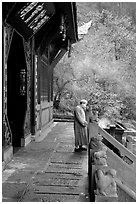 Monk in front of Jieyin Palace. Emei Shan, Sichuan, China (black and white)