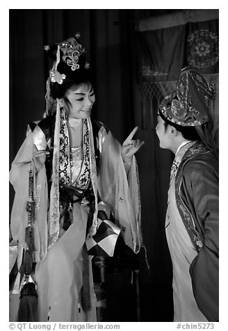 Two characters of Sichua opera on stage. Chengdu, Sichuan, China (black and white)