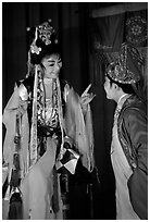 Two characters of Sichua opera on stage. Chengdu, Sichuan, China ( black and white)