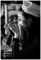 Sichuan opera actress applies makup. Chengdu, Sichuan, China ( black and white)