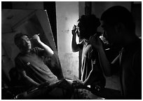 Two Sichuan opera actors apply makup before the performance. Chengdu, Sichuan, China ( black and white)