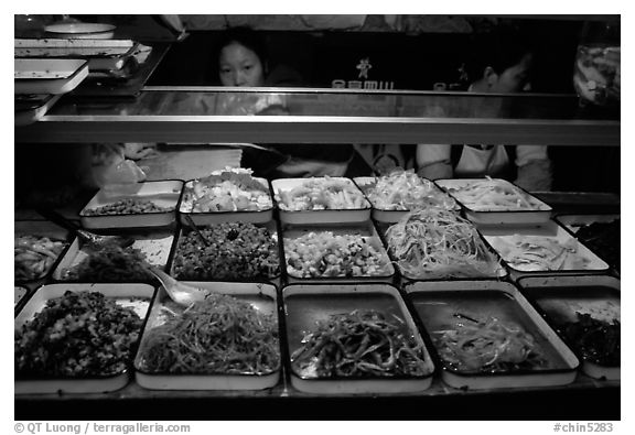 Food stall by night. Sichuan food is among China's spiciest. Chengdu, Sichuan, China (black and white)