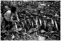 Retriving a bike in the bicycle parking lot. Chengdu, Sichuan, China ( black and white)