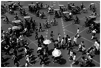 Pedestrians and bicyclists cross a major avenue. Chengdu, Sichuan, China (black and white)
