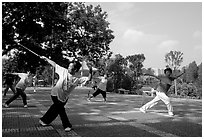 Collective exercise gymnastics with swords,  Liuha Park. Guangzhou, Guangdong, China (black and white)