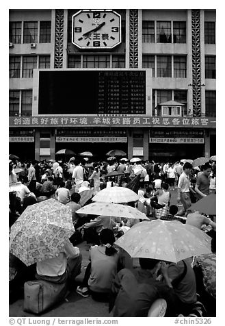 Crowds waiting outside the main train station. Guangzhou, Guangdong, China (black and white)