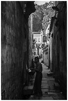 Man using stream water in alley. Hongcun Village, Anhui, China ( black and white)