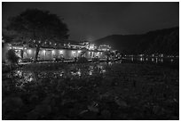 Houses reflected in South Lake at night. Hongcun Village, Anhui, China ( black and white)