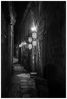 Alley with lanterns at night. Hongcun Village, Anhui, China ( black and white)