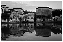Houses reflected in Moon Pond. Hongcun Village, Anhui, China ( black and white)