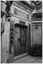 Door with red caligraphed banners. Hongcun Village, Anhui, China ( black and white)