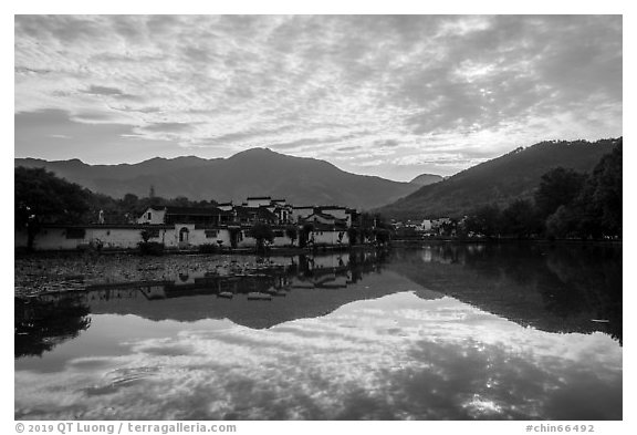 Village and clouds reflected in South Lake. Hongcun Village, Anhui, China (black and white)