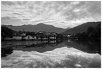 Village and clouds reflected in South Lake. Hongcun Village, Anhui, China ( black and white)
