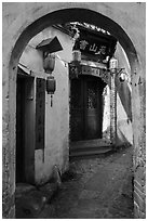 Alley framed by archway. Hongcun Village, Anhui, China ( black and white)