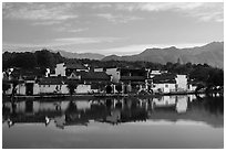 Village reflected in South Lake. Hongcun Village, Anhui, China ( black and white)