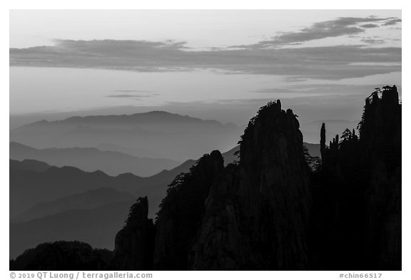 Spires and ridges at sunrise. Huangshan Mountain, China (black and white)