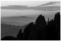 Spires and ridges at sunrise. Huangshan Mountain, China ( black and white)