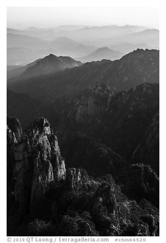 Spires and distant ridges. Huangshan Mountain, China (black and white)
