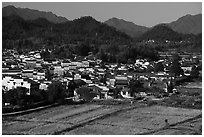 Field workers and village from above. Xidi Village, Anhui, China ( black and white)