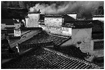 Rooftops and smoke. Xidi Village, Anhui, China ( black and white)