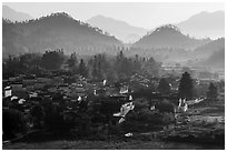 Village and hills in morning fog. Xidi Village, Anhui, China ( black and white)