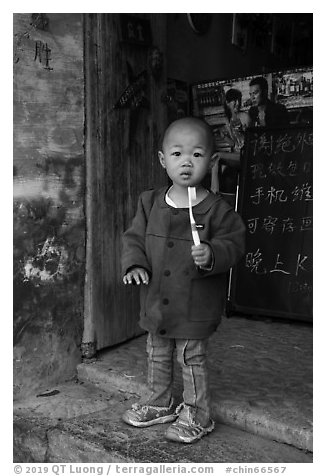Boy with toothbrush. Xidi Village, Anhui, China (black and white)