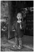 Boy with toothbrush. Xidi Village, Anhui, China ( black and white)