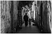 Father and daughter walking in alley. Xidi Village, Anhui, China ( black and white)