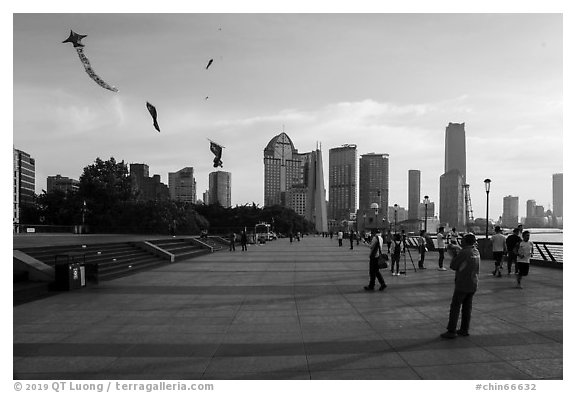 Kites flying above the Bund. Shanghai, China (black and white)