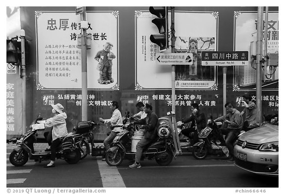 Motercycle riders waiting at trafic light. Shanghai, China (black and white)