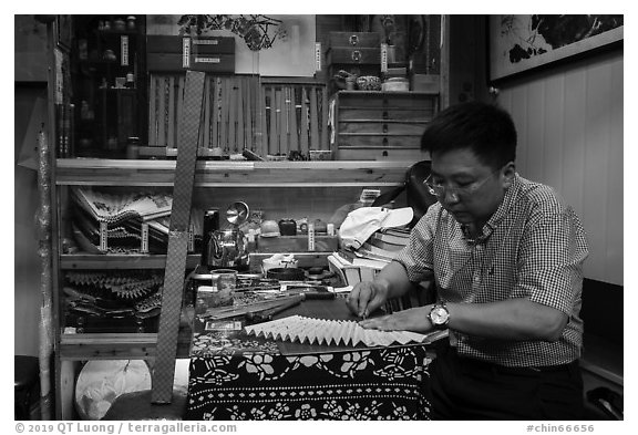 Man working on fan. Shanghai, China (black and white)