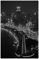 Peoples Memorial and illuminated Bund buildings at night from above. Shanghai, China ( black and white)