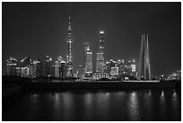 Peoples Memorial and city skyline at night. Shanghai, China ( black and white)