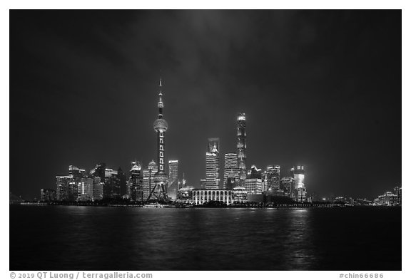 Shanghai skyline with Oriental Perl Tower and Huangpu River at night. Shanghai, China (black and white)