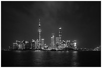 Shanghai skyline with Oriental Perl Tower and Huangpu River at night. Shanghai, China ( black and white)