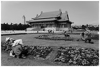 Grounds of Chiang Kai-shek memorial with workers and tourists. Taipei, Taiwan (black and white)