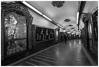 100 meter tunnel lined with brightly painted deities, Guandu Temple. Taipei, Taiwan (black and white)