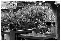 Man reading, Guandu Temple. Taipei, Taiwan (black and white)
