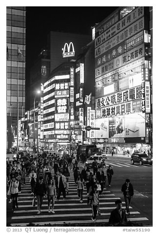 Pedestrian crossing by night and neon signs. Taipei, Taiwan (black and white)
