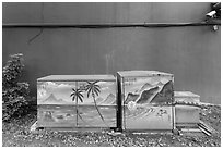 Painted electric utilities boxes with surveillance camera. Taipei, Taiwan (black and white)